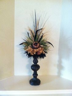This is actually a tile topper floral arrangement that can be placed on top of a candle holder, vase or any flat surface. Faux Flower Arrangement by Greatwood Floral Designs.
