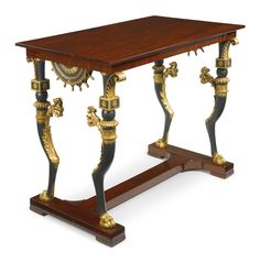A NORTH EUROPEAN NEOCLASSICAL PARCEL-GILT AND PART EBONIZED MAHOGANY CENTER TABLE POSSIBLY RUSSIA, CA 1820 height 31 1/2 in.; width 39 3/4 in.; depth 23 in. / 80 cm; 101 cm; 58.5 cm