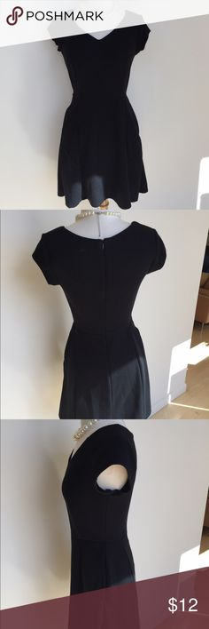 """Gorgeous Black A-Line Dress Soft and fitted a-line black dress. Has a retro feel, with cap sleeves and flared skirt. Has a zipper up the back and pockets! Super flattering but also comfortable. Only worn once. 32"""" bust 24"""" waist 32"""" long. Shell: 99% polyester 1% spandex. Lining 100% polyester. Machine wash cold. Merona Dresses Midi"""