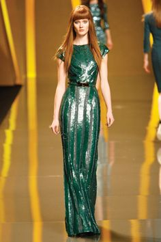 Elie Saab.     Now that I'm a redhead I only wear turquoise because it makes me feel like a mermaid.
