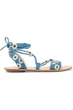 Loeffler Randall's 'Fleura' sandals are made from denim and embroidered with anemone flowers - they're inspired by the blooms you'd find at a farmer's market. Backed in supple leather, they have a signature non-slip sole for a secure step and lace-up ties that elegantly wrap around the ankle.