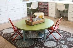 love this little table, small vintage chairs, coke crate atop for writing supplies-great for a school room kid station