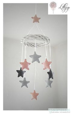 Pinning this for the idea. This beautiful mobile can easily be done with crocheted or knitted stars. Try mix and matching with moons and suns!