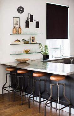 Contrast cool marble with warm leather barstools. Black paint under bar! (by Nate Berkus for Target in Domino)