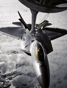 A KC-135 Stratotanker from the Alaska Air National Guard's 168th Air Refueling Wing refuels an F-22 Raptor from the 90th Fighter Squadron at Elmendorf Air Force Base, Alaska. (U.S. Air Force photo/Airman 1st Class Jonathon Steffen)