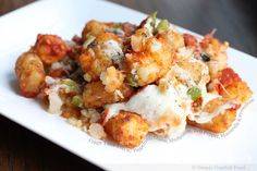 Crispy Tater Tots with Pepperoni, Onion, Mushroom, Bell Pepper, Mozzarella and Provolone  what. what. WHAT