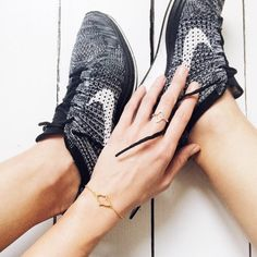 Nike trainers and pretty rings are an obvious choice! Cat Meffan Jewellery