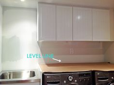How To Install A Countertop Over A Washer And Dryer, DIY floating countertop in the laundry room, countertop cleat, counter over front load washer and dryer Floating Countertop, Countertops, Washer And Dryer, Diy Home Improvement, Room Renovation, Diy Garage Shelves, Storage System, Home Diy, Laundry Room Countertop
