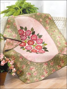This quilt, done in soft colors, brings the beauty of the garden into your home. Use the finished quilt as a wall hanging or a lap quilt. Finished size x Level: Intermediate Lap Quilt Patterns, Sewing Patterns Free, Free Sewing, Free Pattern, Annie's Crochet, Crochet Crafts, Lap Quilts, Small Quilts, Quilting Designs