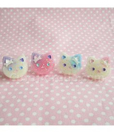 Ive put a creepy cute twist on the glittery galaxy kitty cat rings. This collection has pastel colored kitty cats with cute little bone clips under