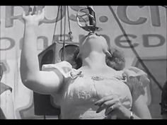 Female Sword Swallower with Cole Bros Circus Sideshow 1942