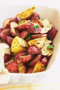 Barefoot Contessa - Recipes - Garlic Roasted Potatoes || loved this... especially with some melted butter and parsley and dill poured over the potatoes right after taking them out of the oven. Could also use a bit of lemon depending on what it's being served with.