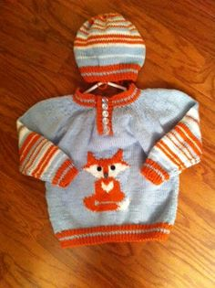 Here is my grandson's first birthday present - his name is Henry Fox, which is why I have knitted so many Fox designs. The pattern was from www.ravelry.com/patterns/library/colorwork-baby-pullover.  I changed it to knit the fox motif which I have put next to this photo.  You may use if you wish.