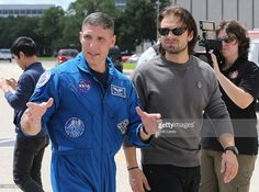 Col. Michael S. Hopkins, USAF, NASA Astromaut explains to Sebastian Stan the workings of the space exploration vehicle during his visit at Lyndon B. Johnson Space Center on September 15, 2015 in Houston, Texas.