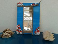 driftwood, pebble houses, pearls n coral became a nice mirror