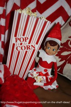 Elf Catches a Movie and Eats Popcorn in this easy Elf on the SHelf Idea. Daily Photos and FREE Elf Notes on Frugal Coupon Living.