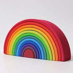 This stunning rainbow stacker is a versatile wooden toy that fosters creativity.It provides your child with endless opportunities for learning and creative play.Perfect for building farm fences, doll houses, dwarf villages, tunnels, marble runs . Grimm's Toys, Baby Toys, Toddler Toys, Kids Toys, Arco Iris Waldorf, Grands Arcs, Feng Shui, Grimms Rainbow, Rainbow Family