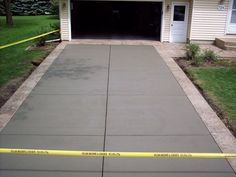 "Natural gray concrete driveway with Seamless Italian Slate textured 12"" border, Mendota Buff base color, Pecan Tan release"