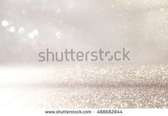 stock-photo-glitter-vintage-lights-background-silver-and-white-de-focused-488682844.jpg (450×312)