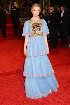 To the 70th annual British Academy Film Awards 2017, Rising Star Award Nominee Anya Taylor-Joy wore a Gucci Spring Summer 2017 tulle gown with plissé bell sleeves, embellished tiger bodice and tiered plissé skirt by Alessandro Michele.
