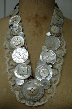 There are 42 white mother of pearl buttons sewn on a portion of a neutral silk tie, with an added vintage lace collar. Sold by on Etsy. Button Art, Button Crafts, Button Necklace, Necklace Holder, Necklace Set, Pearl Necklace, Jewelry Crafts, Handmade Jewelry, Gemstone Brooch