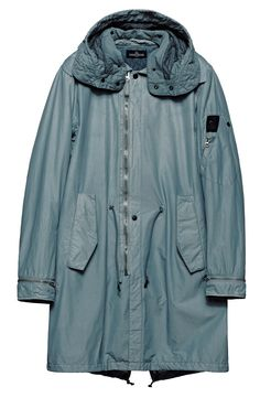 70504 FISHTAIL PARKA_NYCO CANVAS WITH THERMAL INSULATION Fishtail parka in NYCO, nylon/cotton canvas resin-treated on the inside for water and wind resistance. Garment dyed with double dyeing recipe. Large detachable hood with inner edging and wind flap on the neck, double-layered in cotton nylon canvas, lightly padded and quilted with a star pattern. Two diagonal pockets with flap and hidden snap fastening.
