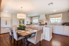 Joanna Gaines designed the kitchen island with dining table and booth seating at… - Modern Booth Seating In Kitchen, Kitchen Island Dining Table, Kitchen Design, Kitchen Island Design, Joanna Gaines Dining Room, Kitchen Room, Kitchen Remodel, Kitchen Dining Room, Living Room Kitchen