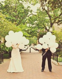 Hiding behind white balloons - Chicago Wedding at A New Leaf from Stinky Feet Photography