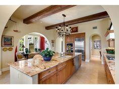 Center island kitchen - chandelier - wood ceiling beams - Mediterra in Naples, FL