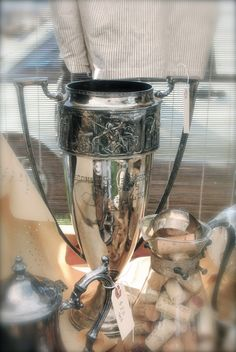 Vintage trophies are all the rage....they can add charm and character to any mantel or bookcase...example via Room 363