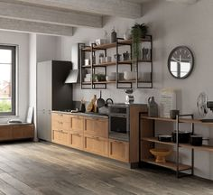 A design with a more traditional feel, fitted with wall units and adorned with the new frame door in Land Oak decorative melamine. The dark shade of the worktop and plinth frames the base units of this Scavolini Basic model with boldness. Industrial Kitchen Design, Rustic Kitchen Cabinets, Kitchen Cabinet Design, Urban Kitchen, Loft Kitchen, Kitchen Interior, Casa Top, Kitchen Modular, Modern Tiny House