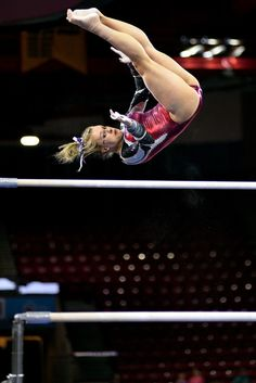 University of Denver gymnast Julia Ross performs a Gienger on bars. Photo taken on March 7 2015 in Magness Arena at DU. Cheerleading Flexibility, Gymnastics Stunts, Gymnastics Tricks, Gymnastics Posters, Gymnastics Photos, Artistic Gymnastics, Olympic Gymnastics, Gymnastics Girls, Female Superheroes And Villains