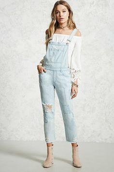 a2a43f45 A pair of denim overalls featuring a dual pocket bib patch, adjustable  straps, five
