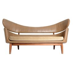 The Best Finn Juhl Sofa. A powerful rare Finn Juhl sofa. This floating back organic masterpiece is the only example in existence with original leather upholstery. Custom ordered in the 1950's for the President of Herman Miller Canada.