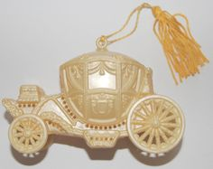 Avon Vintage Perfume Pomander Gold Carriage Cinderella Coach. 1983. With a gold tassel. Made in Italy.