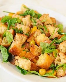 Panzanella (bread salad) with sungolds and ground cherries.