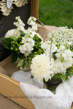 simple white & green flower arrangments in mason jars