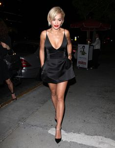 After news of Rita Ora's breakup with Calvin Harris emerged Friday, the vocalist stepped out in a revealing dress.