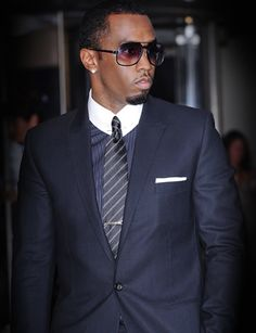 Sean Combs aka Diddy aka Sean John.  Bojo Note:  whatever he is calling himself these days, he's a sharp dresser.