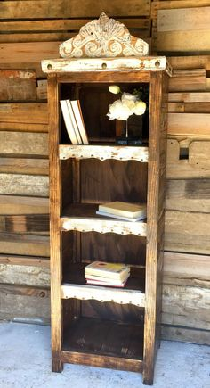 A gorgeous signature piece that will be center of attention in any room of the house. A great book shelf for the den or bedroom but also a unique piece to add to a bathroom! Wood Stain splashed with w