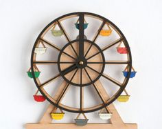 Around We Go Clock by TheMakeLab on Etsy. x Display as desk clock or wall clock, both will entertain you as you slowly watch time spin by. Cute Ferris Wheel Wooden Clock: such a cute idea for any kids room. State of Green wooden clock This is a definite s Clocks For Sale, Cool Clocks, Wooden Clock, Wooden Walls, 3d Laser Printer, World Clock, Displays, Wall Clock Design, Diy Clock