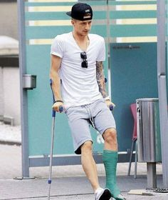 Germany's Marco Reus struggling on crutches after being ruled out of this summer's World Cup in Brazil. Soccer Fans, Soccer Players, Thomas Muller, Football Pitch, Mario, Fifa World Cup, To My Future Husband, Menswear, Sporty