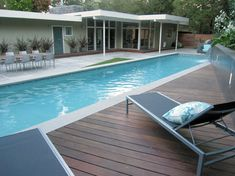 """Pool Deck is Ipe, the pool coping is a light grey limestone and the paving is 3x3' concrete pavers in """"porcelain."""""""