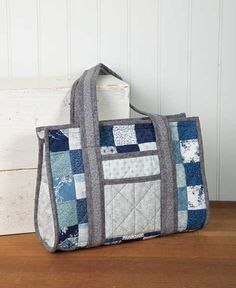 http://www.connectingthreads.com/kits/Baby_Sister_Purse-Strips_Version_Kit__D6280.html