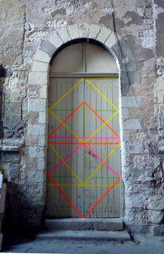 door with neon geometric pattern. contrast!