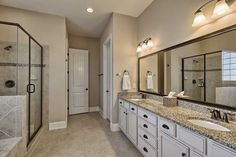 Traditional Master Bathroom with New Caledonia Granite Countertop, Arizona, MS International Ramon Grey Limestone Tile