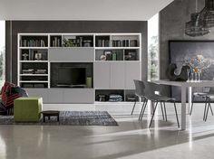 Sistema integrato living/libreria di mobilificio Santa Lucia: guadagnare in spazio e aprire al design.