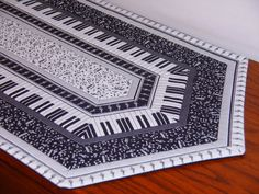 This beautiful black and white piano keys and notes table runner is made out of 100% cotton, front and back. It is the perfect table runner for