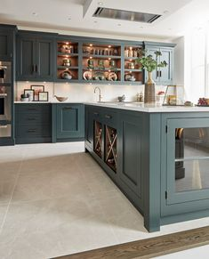 The beautiful bespoke island features integrated wine storage and a combination of open and closed s Kitchen Chairs, Kitchen Dining, Kitchen Decor, Dining Room, Kitchen Layout, Rustic Kitchen, Dark Green Kitchen, New Kitchen, Green Kitchen Island