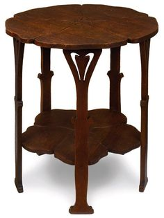 """Early Gustav Stickley table, #3, from the Chips Catalog, carved poppy-form top and lower shelf supported by a five-leg base with organic cut-outs, fine original finish, initialed G.S. on the ca. 1900 paper label, 20""""dia x 23""""h     $4,750 12/7/2008"""